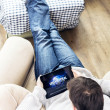 Man watching movie on iPad — Stock Photo #41545199