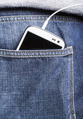 Smartphone in back pocket jeans — Stockfoto