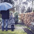 Father and daughter at grave — Stock Photo