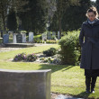 Woman looking at grave — Stock Photo #42178219