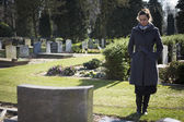 Woman looking at grave — Stock Photo