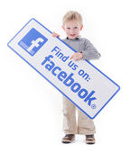 Little boy holding Facebook sign — Stock Photo