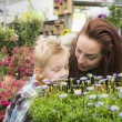 Mother and child in gardening center — Stock Photo #44734071