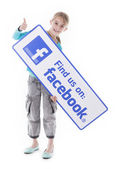 Girl holding like us Facebook sign — Stock Photo