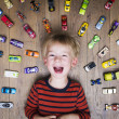 Boy on floor with cars — Stock Photo