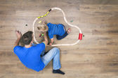 Father and son playing with toys — Stock Photo