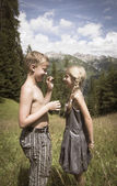 Boy and girl in mountains — Photo