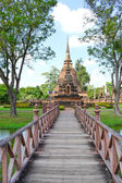 Red painted bridge that leads to an island temple in Sukhothai T — Stock Photo