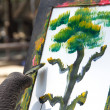 Elephant and painting - Stock Photo