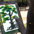Elephant artist painting - Stock Photo
