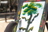 Elephant and painting — Stock Photo