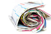 Roll of newspapers, isolated on white background — Stock Photo