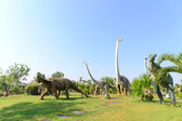 Public parks of statues and dinosaur — Stock Photo