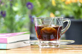 Cup of tea and books — Stock Photo