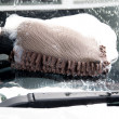 Cleaning car using a sponge — ストック写真