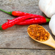 Bright spices and garlic on an old wooden — Stock Photo