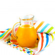 Orange juice in pitcher  on white background — Stock fotografie