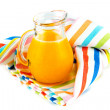 Orange juice in pitcher  on white background — Stockfoto