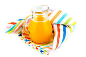 Orange juice in pitcher on white background — 图库照片