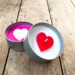 Heart shaped candles on wooden — Stock Photo