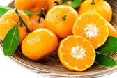 Fresh juicy tangerines in bowl — Stock Photo