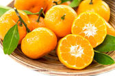 Fresh juicy tangerines in bowl — Stock Photo