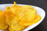 Potato chips in bowl — Stock Photo