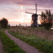 Kinderdijk windmill at sunrise — Stock Photo