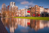 Rotterdam architecture reflected in river — Stock Photo