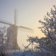 Stock Photo: Dutch winter landscape with windmill and snow