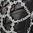 Tire with snow chains — Stock Photo