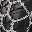 Tire with snow chains — Stock Photo #26680471