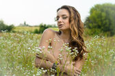 Naked girl posing in a field — Stock Photo