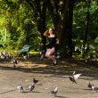 Girl in a black dress  jumping in the park — Stock Photo