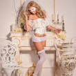 Girl in white veil and mask in lingerie — Stock Photo #32068193