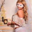 Girl in white veil and mask in lingerie — Stock Photo #32068263