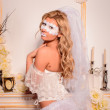 Girl in white veil and mask in lingerie — Stock Photo #32068285