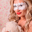Lady in white mask and vail with teddy bear — Stock Photo #32068437