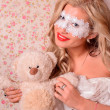 Lady in white mask and vail with teddy bear  — Stock Photo