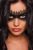 Lady in lacy black mask — Stock Photo