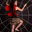 Girl dressed as butterfly in a web from chains — Stock fotografie