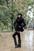 Woman at the park in rainy day — Stock Photo