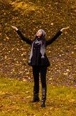 Young woman enjoying in autumn park — Stock Photo