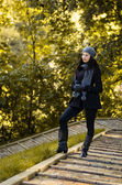 Girl in the autumn park on the stairs — Stock Photo