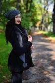 Woman posing in autumn park — Stock Photo