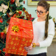 Girl with big gift near the Christmas tree  — 图库照片