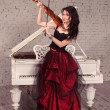 Violinist girl in red dress — Stock Photo