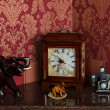Retro clock, elephant figurines and camera — Stock Photo