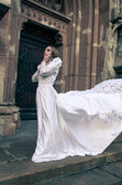 Woman posing in a wedding dress — Стоковое фото