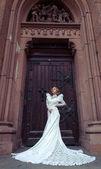 Woman posing in a wedding dress — Zdjęcie stockowe